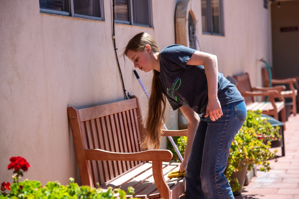 A person sitting on a bench  Description automatically generated