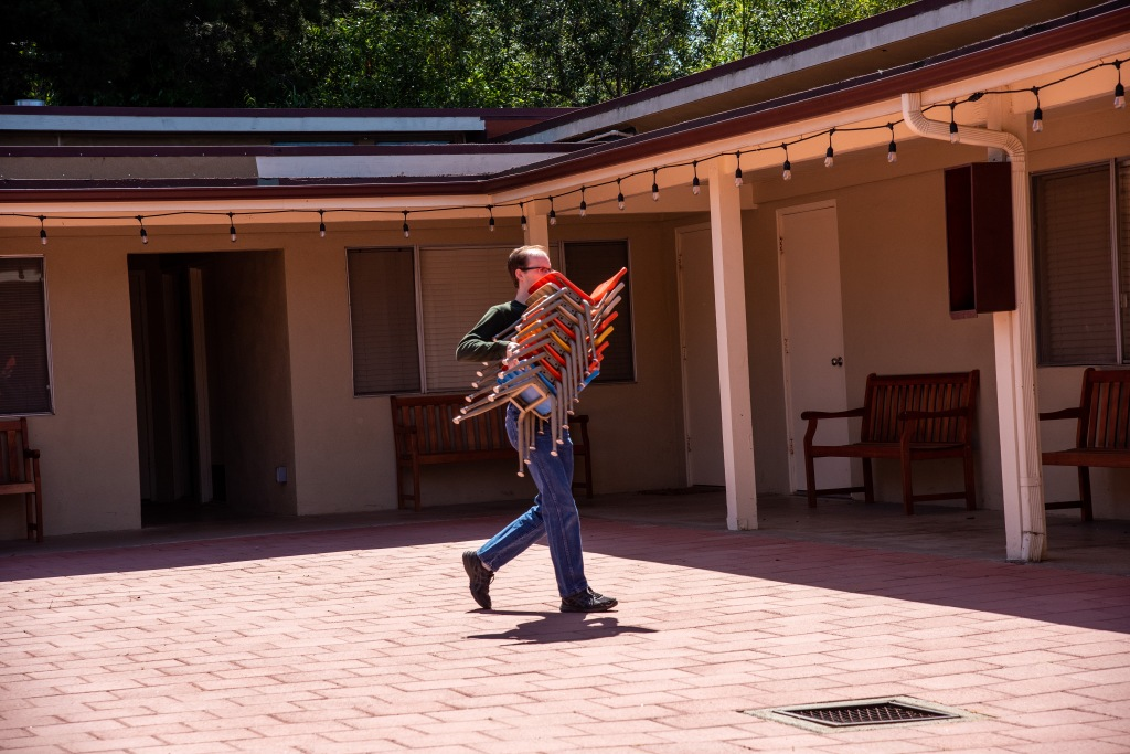 A picture containing outdoor, building, man, young  Description automatically generated
